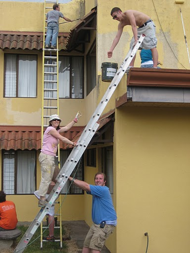 Shelly and students repairing a house